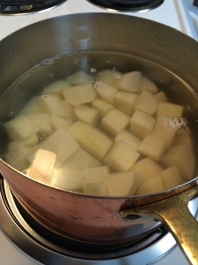 Potatoes ready to bring to a boil and then simmered until fork tender.